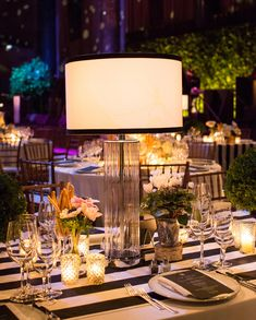 Glamorous wedding reception with modern lamp centerpieces