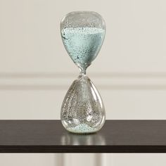 Features:  -Primary Material: Glass.  -Time span: One hour.  Product Type: -Hourglass.  Style: -Contemporary/Glam.  Theme: -Historic.  Subject: -Home decor and furniture.  Handmade: -Yes.  Primary Mat