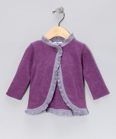 Soft, luxurious pima cotton is a great choice for little ones. This cozy sweater features a single button closure and pretty ruffle trim.100% pima cottonMachine wash; tumble dryMade in Peru