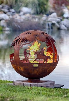Round Up fire pit sphere features a ranch theme with a cowboy on a horse roping a calf, cattle and a cowboy watching the ranch activities with a small boy