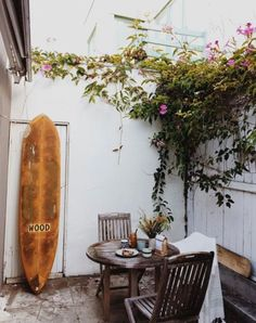 rustic surfboard in outdoor patio area. / sfgirlbybay