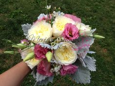 a vintage bouquet with white patience garden roses, pink lisianthus, white wax flower and dusty miller.