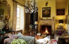 Warm, comfortable room...love the wall color, carved mantle, seating, floor (Robert Kime)
