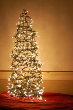 Small space DIY Christmas tree ideas // use a tomato cage and lights as a do it yourself tree