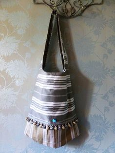 A stunning messenger bag, funky, retro and unique! Grey vintage French ticking!