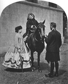 Queen Victoria on horseback with Princess Louise and John Brown, April 1865, walking dress pulled up with skirt lifters.