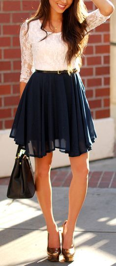 white lace shirt with a nice dark skirt.