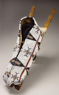 American Indian Art:Beadwork, A NORTHERN CHEYENNE BEADED HIDE BABY CARRIER. c. 1880. ...