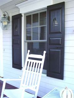 Shutters with sailboat cutouts