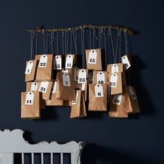 Advent calendar to be filled with seasonal goodies for your countdown to Christmas.You will get - tags with number 1-25 - 10 envelopes A6 - 4 boxes 7,5x7,5x3,5 cm - 11 bags 15,0x6,0x27,5 cm - 8m black & white twine.Made from kraft brown paper, cotton twine, paper.The kit will come wrapped in a cello bag.