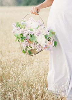 rustic basket bouquet - photo by kurt boomer