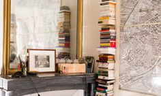 Really Parisian Studio Apartment: Glazed Doors, Marble Table, Candles, Fireplaces, Paintings, Enormous Chandelier, Threadbare Parquetry And No Closets interior design ideas