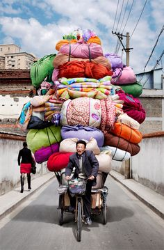 Vietnam is known for its cargo bikes, but these delivery men and women in China make the pedalers of Saigon look like pansies. Photographer Alain Delorme became fascinated with the bike haulers of China