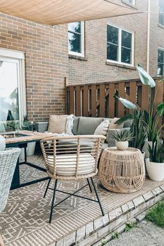 Light synthetic wicker makes the Tula ready to withstand a tropical storm or a typical Nor-easter. A Lily White weather-proof cushion needs a little more TLC (please don't leave it in the rain!) but promises to keep your butt dry and cozy for seasons to come. Photo by Brianne Penney. #OutdoorDecor #BohoPatio #PatioIdeas Lily, Chair, Outdoor Decor, Orchids, Stool, Lilies, Chairs