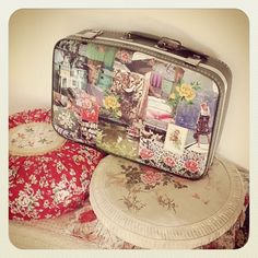 diy mod podge a vintage suit case and use it for art supplies, days at the park, odds and ends......  dottie angel