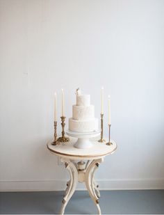 Cake table: White Modern Seattle Wedding - Blue Rose Photography featuring vintage props & decor from Vintage Ambiance | Libby white with gold parlor table #vintagewedding #vintagedecor #caketable