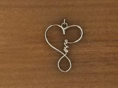 """Love pendant - """"love"""" spelled out in a heart/infinity symbol shape"""