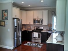 Two tone Kitchen.  White Painted wall cabinets & Espresso Glazed base cabinets.  Nester's Kitchen & Bath, Conway, NH