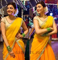 """South India beauty Kajal agarwal beautiful expresssions in half saree from tamil """"Maari"""" movie. The unmarried actress is awesome in orangenet half saree."""