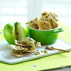 Fresh-snipped chives add a kick to pistachio-laden crackers; serve them with tart green apple slices and pungent Dijon mustard with capers and herbs.