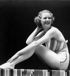 Thirteen years after women are allowed to compete in the Olympics, Carl Janzten introduces a two-piece bathing costume in 1913. In Europe, during the 1930s and '40s, women start wearing bathing outfits that reveal a sliver of skin at the waist, and suits shrink stateside as fabric is rationed during World War II. For the most part, hems are shortened and skirts eliminated, but in some cases they do split into two.