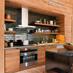 Naturally modern wood homes with wood clad panelling in kitchen