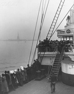 Passengers aboard the Olympic view the Statue of Liberty for the first time in the New York Harbor. 1921