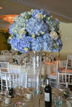 Wedding centerpiece with blue hydrangea and white roses, by Terri's Flower Shop in Naugatuck, CT.
