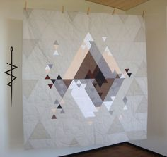 Patchwork quilt for sofa with triangles graphic, dolomites mountains, grey and pastels.