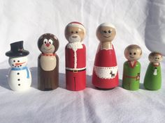 These little pegs are perfect for any little kid excited for the holidays. Hand painted wooden pegs, sealed and sprayed to a semi gloss finish, they