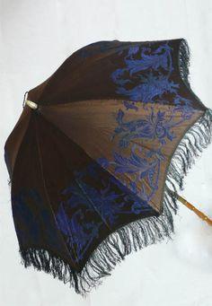 fringed parasol    Google Image Result for http://www.dressing-history.co.uk/pages/images/orig/parasol.jpg