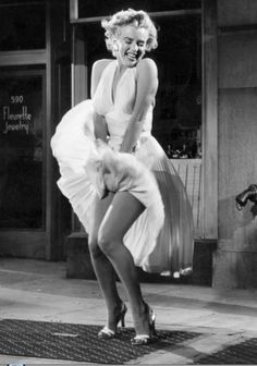 Famous Pictures Marilyn Monroe | Marilyn Monroe strikes her famous pose in her white halter dress from ...