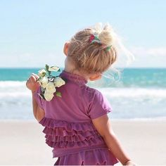 """Beach Day With Kids  Must have products for kids while at the beach: 1.  SwimZip 2.  Sun Hat 3.  Lots of Water 4.  Amazing towels 5.  A place for mom to relax - no stress with SwimZip!  Baby Girl Rash Guard Swimsuit Set (2 Piece) with UPF 50+ UV - """"Ruffle Me Pretty Purple"""""""