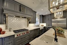 White Beveled Arabesque Tile Backsplash is Stunning and is perfectly paired with the honed crema marfil marble countertops. The gorgeous grey cabinets completes this perfect d Arabesque Tile Backsplash, White Kitchen Backsplash, Herringbone Backsplash, Kitchen Tiles, Hexagon Backsplash, Travertine Backsplash, Beadboard Backsplash, Backsplash Ideas, Marble Countertops