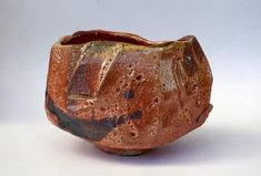 This is a handformed faceted tea bowl carved out of stoneware clay. It was decorated with an iron oxide slip, partially glazed in a shino style glaze and fired in my wood kiln for 18 hours to No toxic materials were used in making this bowl, it is f Slab Pottery, Pottery Vase, Ceramic Pottery, Stoneware Clay, Porcelain Ceramics, Ceramic Bowls, Pottery Sculpture, Sculpture Clay, Ceramic Sculptures