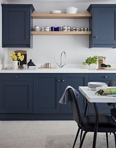 Fantastic kitchen features navy blue shaker cabinets for John lewis kitchen units