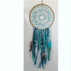Beautiful dreamcatcher inspired by the ocean  15cm diameter web  Approximately 40 - 50 cm total hang   Intricately weaved by hand in beautiful shades of blue, teal, sand and white Adorned with beads and feathers and finished with amazing braiding  Will look amazing in any bedroom!  Every p...
