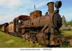 this rusted train represents a box sculpture because the form and shape of the train is basically a bunch of geometric shapes welded together.