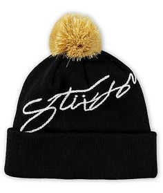 A gold pom pom at the top and a white embroidered Stussy logo finish this cuffed style beanie made with a cozy and comfortable ribbed knit construction.