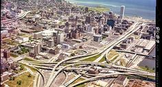 Downtown Milwaukee Is that history? It's funny to see the freeway to nowhere in the upper left. You could have walked into the ramp from my brother's bar. And Aldrich Chemicals, smack dab in the middle of the interchange! Milwaukee Downtown, Milwaukee Wisconsin, Wauwatosa Wisconsin, Old Trains, City Buildings, Best Cities, Aerial View, West Virginia, Day Trips