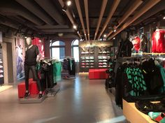 Horizontal timber slats across the roof draws the eye to the shoes at the back of the store! Puma concept store, Amsterdam November 2014