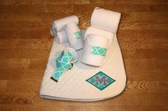Teal Quatrefoil Diamond Monogram Full Set, $85.00 by KLMequestrian. Show off in this complete gift set for you and your horse! Customized with your monogram on the saddle pad. 1 Monogrammed saddle pad with diamond applique and lettering in thread color of your choice. 4 Standing wraps (horse or pony size), 4 Polo wraps (horse or pony size), 1 D-ring adjustable belt (adult or youth)