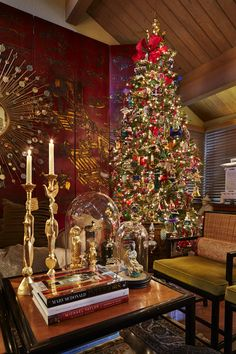 At first glance, Christmas at David Windstrup and Eric Hurt's place looks just lovely. Flames in the fireplace tickle at the bricks and mortar. Garland overhead sags against a mirrored wall, doubling the effect of its holiday cheerfulness. The beribboned...