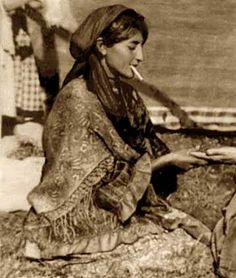 Gypsy woman reading a palm.