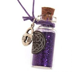 A wonderful little bottle pendant full of colourful Witches Glitter dust.  The bottle measures 35mm tall x 15mm wide.  The pendant is gift boxed and comes complete with a coloured cord and little pewter charm.  Within this pendant is a guardian spell  To keep you protected so no harm can pre