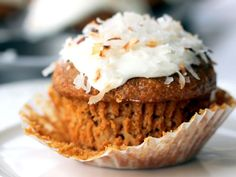 Healthy Whole Grain Carrot Coconut Morning Glory Muffins by ambitiouskitchen: These muffins are made with whole wheat flour, coconut flakes, carrots, raisins, and walnuts, and applesauce instead of oil to save calories. 188 calories/muffin  #Muffins #Morning_Glory #Carrots #Aplesauce #Almond_Milk #Coconut #Healthy