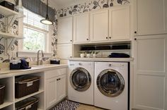 I have a thing for beautiful laundry rooms! Love this black and white one...