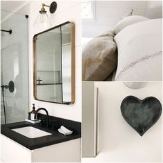 I love this guest bath with a wall mounted vanity topped with black honed granite and a brass mirror from Rejuvination.
