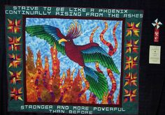 Fighting Phoenix. Our UWGB college mascot is the Fighting Phoenix. We have traveled with the girls basketball team to all of their NCAA tournaments for the past 10 years. I decided we needed a 'sign' to hold up in the crowd. Once again, I got a little carried away and made this art quilt to do the job. We take it with us to the NCAAs every year, and it has been on ESPN several times. It was the opening shot for our local news broadcast the year we made the sweet 16. Go Phoenix!!!!