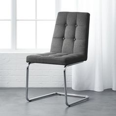 Shop roya grey chair.   Designed by Jannis Ellenberger, Roya is the perfect mix of comfort and design.  Chrome base stages an elegantly tufted grey woven seat with a little bit of give.